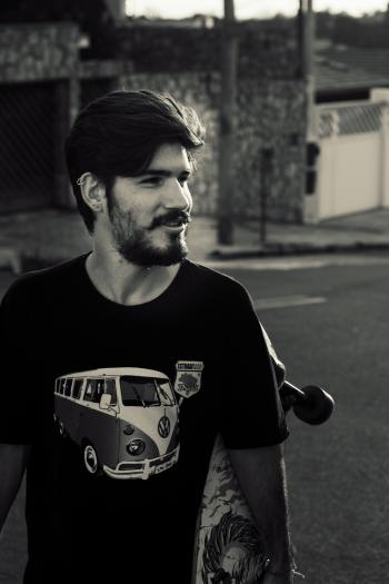 Grayscale Photography of a Man Wearing Black Crew-neck Shirt