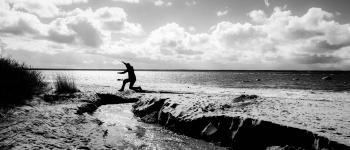 Grayscale Photography of a Person Jumping over Body of Water