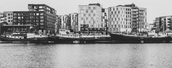 Grayscale Photography Of Buildings And River