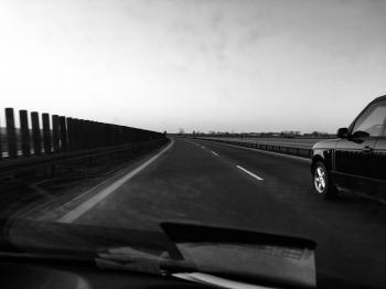 Grayscale Photography of Car on Road