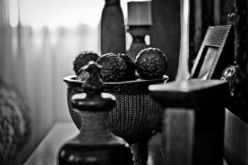 Grayscale Photography of Home Decorations Near Window