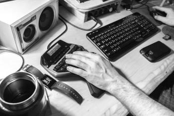 Grayscale Photography of Human Left Hand Near Computer Keyboard