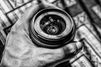 Grayscale Photography of Person Holding Dslr Zoom Lens