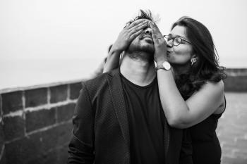 Grayscale Photography of Woman Covering Eyes of Man