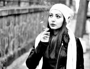 Grayscale Photography Of Woman Smoking