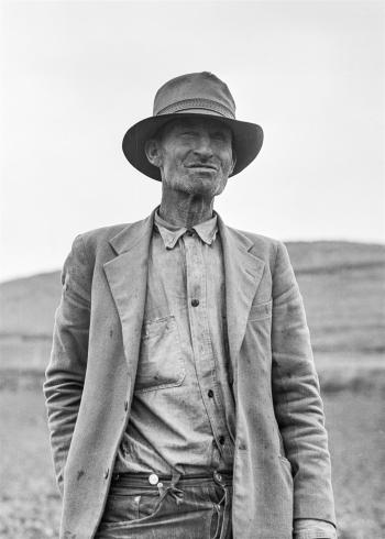 Grayscale Portrait of a Man in Suit Jacket and Panama Hat