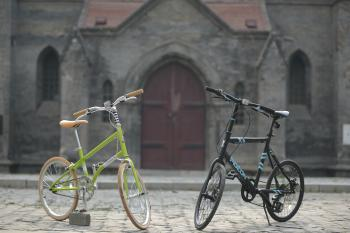 Green Bike Beside Black Bike