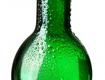 Green bottle with water drops