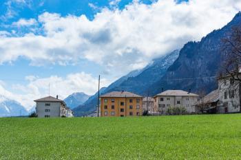Green Grass Field Across Houses