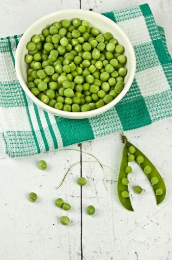 Green Peas On White Ceramic Bowl