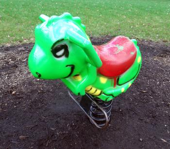 Green playground rocking dinosaur