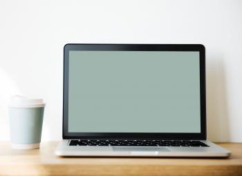 Grey and Black Laptop Beside White and Teal Coffee Cup