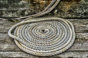 Grey Braided Rope on Wooden Plank