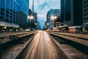 Grey Highway Between High Rise Building