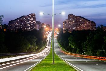 Grey Lamp Port Between Grey Concrete Road