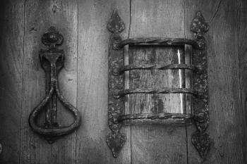 Grey Metal Knocker on Brown Wooden Door