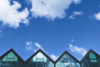 Grey Wood and Glass House Under Blue Sky and Clouds during Daytime