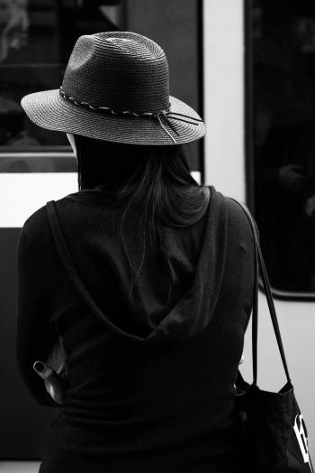 Greyscale Photo of a Woman Wearing a Hat