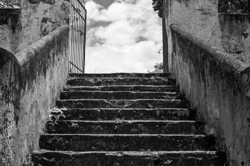 Greyscale Photo of Concrete Staircase
