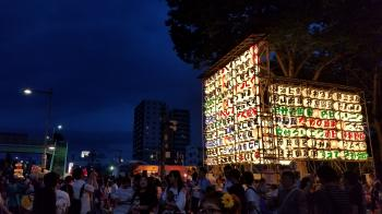 Group of People Near Multicolored Lantern Display