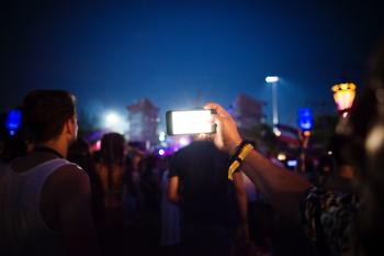 Group of People Using Smartphones during Nighttime