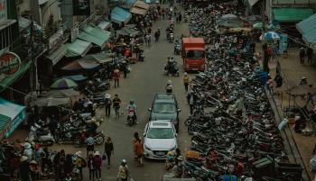 Group of People Walking Through Market