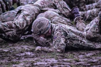 Group of Soldiers Crawling on Mud