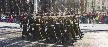 Group of Soldiers Parading on Concrete Road