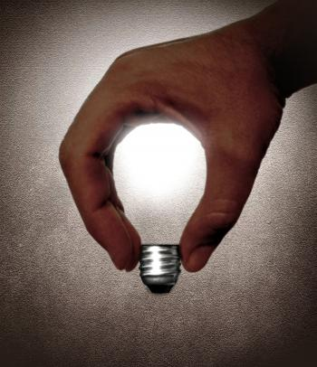 Hand and lightbulb - Creativity and idea
