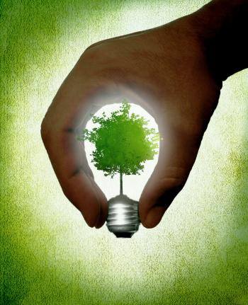 Hand creating a lightbulb