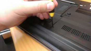 Hand holding a laptop screwdriver