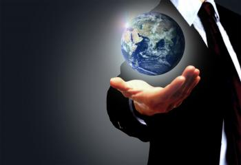 Hand of a businessman holding Earth globe - Globalization concept