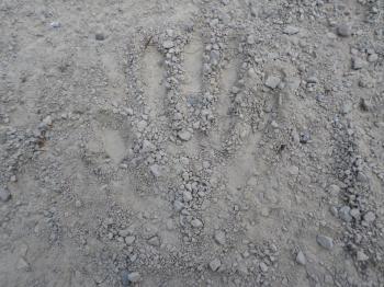 Hand print in gravel