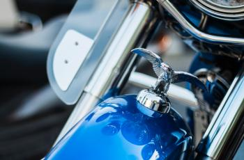 Harley Davidson Emblem on Top Front of Blue Motorcycle