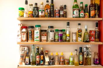 Herbs and oil bottles in kitchen