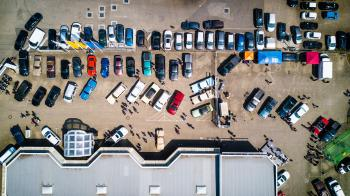 High-angle Photo of Vehicles Parked Near Building
