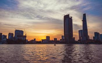 High-rise Building in Front of Body of Water during Sunset