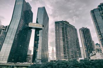 High Rise Buildings Under Cloudy Sky