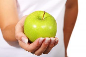 Holding Apple