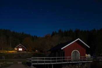 Holma Boat Club in moonlight under the Big Dipper