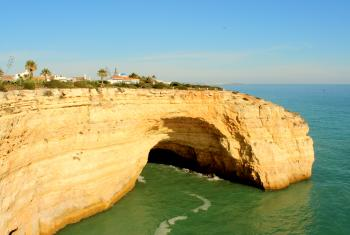 Houses atop a huge cliff in Algarve
