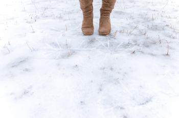 Human Standing on Frosted Ground
