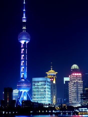 Illuminated City Skyline at Night