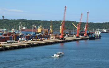 Industrial harbour behind the rocks