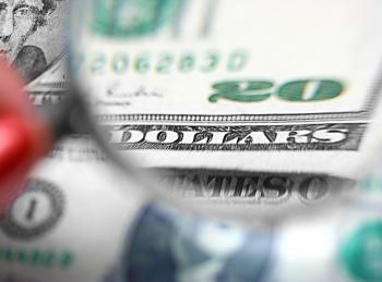 Inspecting A Twenty Dollar Bill