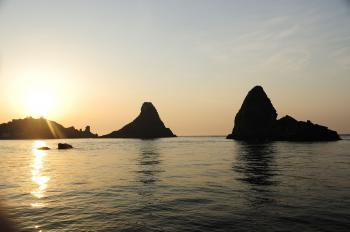Islands of the Cyclops at Dawn Sicily Italy - Creative Commons by gnuckx