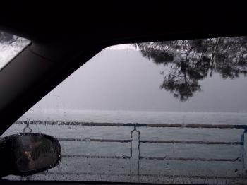 Lake from a wet window of a car