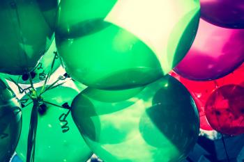 Landscape Photo Of Green and Red Balloons