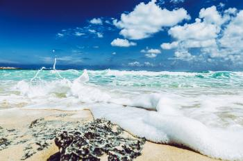 Landscape Photography of Beach With Raging Waves Under Clear Skies