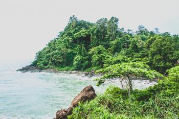 Landscape Photography of Mountain Beside Sea